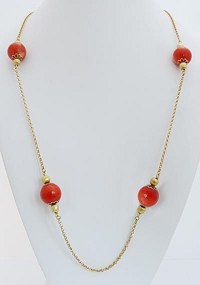 A GILT SILVER AND CORAL NECKLACE