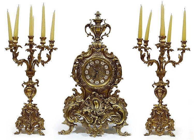 A GILT BRONZE CLOCK GARNITURE