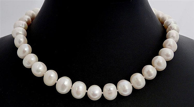 A SILVER AND PEARL NECKLACE