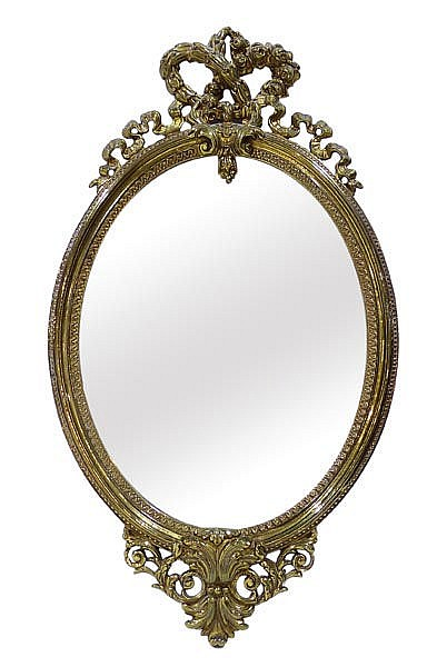 A BRONZE WALL MIRROR