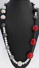A QUARTZ, ONYX, AGATE AND CORAL NECKLACE