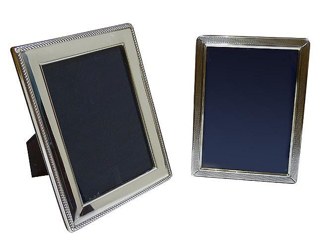 A PAIR OF STERLING SILVER PHOTOGRAPH FRAMES