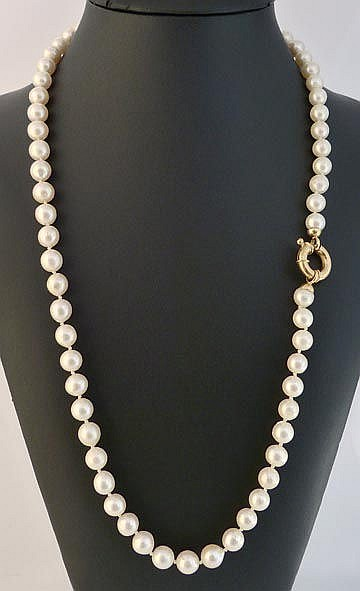 A GOLD AND PEARL DROP NECKLACE