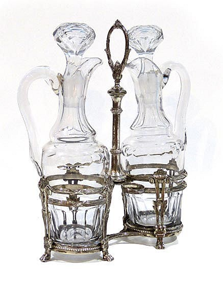 A VINTAGE STERLING SILVER AND CRYSTAL CRUET SET