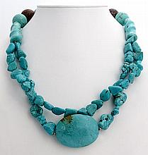 A SILVER AND TURQUOISE NECKLACE