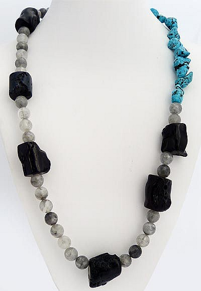 A SILVER, ONYX, QUARTZ, CORAL AND TURQUOISE NECKLACE
