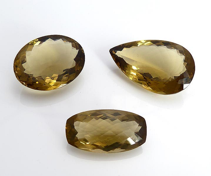 A SET OF FOUR SMOKY QUARTZES