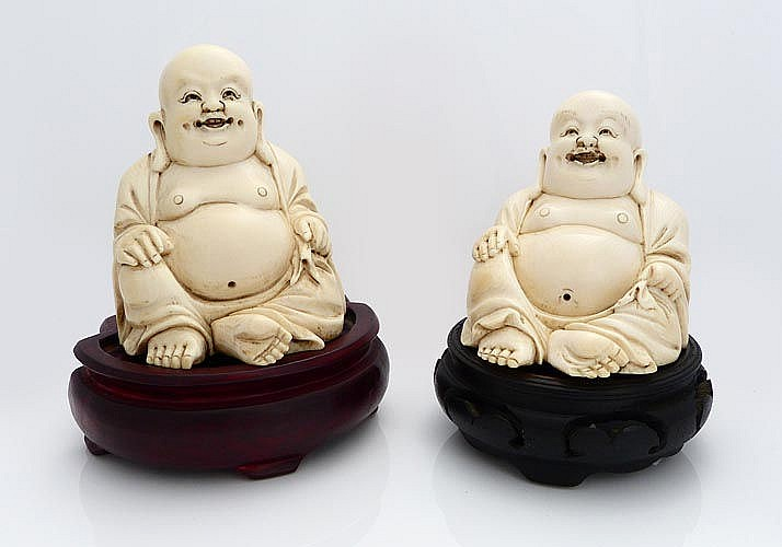 A PAIR OF CARVED IVORY BUDDHAS