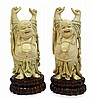 A PAIR OF ANTIQUE CARVED IVORY FIGURES