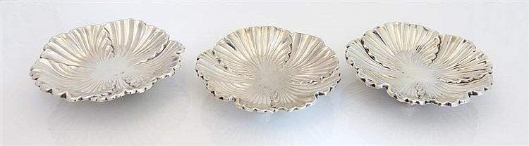 A SET OF THREE STERLING SILVER DISHES