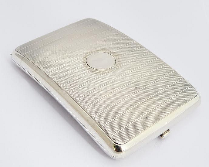 AN ENGLISH STERLING SILVER CIGARETTE CASE