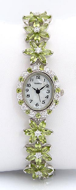A SILVER, ZIRCON AND PERIDOT WRISTWATCH, BY QUARTZ