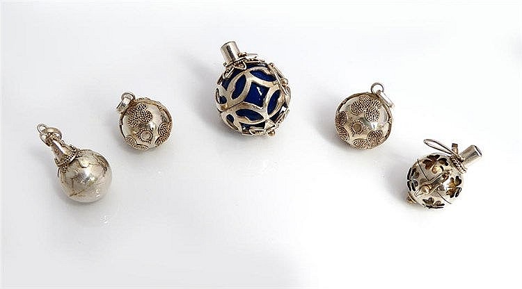 A SET OF FIVE SILVER PENDANTS
