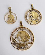 A SET OF THREE GILT SILVER PENDANTS