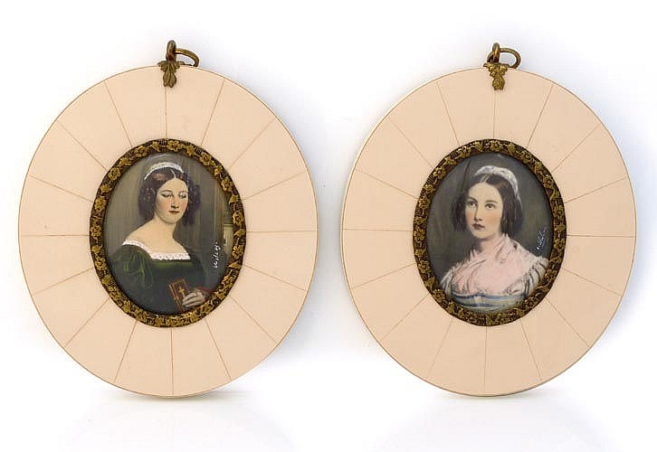 A PAIR OF MINIATURE IVORY PORTRAITS