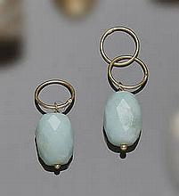 A PAIR OF GOLD AND GREEN GEMSTONE PENDANTS