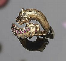 A GOLD, RUBY AND ZIRCON RING