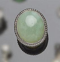 A SILVER AND GREEN JADE RING