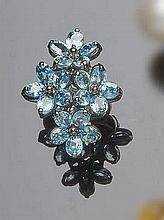 A SILVER AND TOPAZ RING