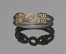 A STEEL AND GOLD RING