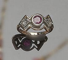 A GOLD, SILVER, RUBY AND DIAMOND RING