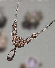 A GOLD AND GARNET NECKLACE