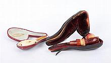 A PAIR OF ANTIQUE MEERSCHAUM SMOKING PIPES