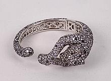 A STERLING SILVER AND ZIRCON BANGLE BRACELET