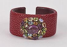 A SILVER, CITRINE, PERIDOTE AND AMETHYST BANGLE BRACELET