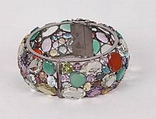 A STERLING SILVER AND MULTI-COLORED GEMSTONE BANGLE BRACELET