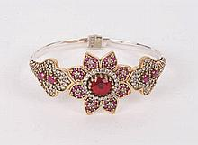 A SILVER, BRONZE, RED GEMSTONE AND ZIRCON BANGLE BRACELET