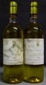 2 Bouteilles  DOISY DAËNE étiquettes tachées, legèrement abîmées.  Labels stained, slightly damaged.  1978