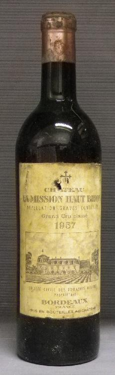 1 Bouteille MISSION HAUT BRION Niveau mi épaule, étiquette tachée, capsule  abîmée.  Level mid shoulder, label stained, capsule shows some damage.  1957