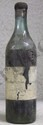 1 Bouteille  GRAND BAS ARMAGNAC  Etiquette tachée, abîmée, niveau basse épaule, capsule cire légèrement abîmée, verre ancien, mise probable année 40.  Label stained, damaged, level low shoulder, bottle from the 1940's.   1904