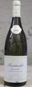 1 Bouteille MONTRACHET - E.  SAUZET Etiquette trés légèrement tachée,  trés  légèrement griffée.  Label lightly stained, slightly scratched.  2002