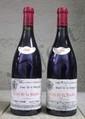 2 Bouteilles CLOS DE LA ROCHE - D.  LAURENT Etiquette légèrement tachée, très légèrement abîmée.  Label lightly stained, slightly damaged.   1999