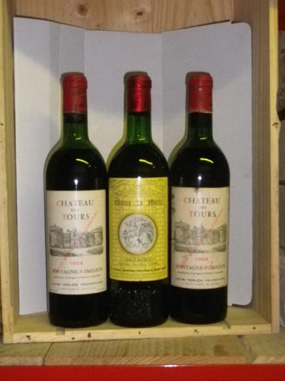 3 Bouteilles 2 BOUTEILLES Ch. DES TOURS - MONTAGNE ST EMILION Etiquettes légèrement tachées, Niveaux mi épaule, labels lightly stained, level mid shoulder. 1964 1 BOUTEILLE Ch. LA MOTHE - HAUT MEDOC Niveau très légèremet bas. Level very top shoulder.