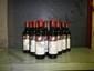 12 Bouteilles MOUTON ROTHSCHILD Caisse bois d'origine ; niveaux : 1 légèrement bas, 1 haute épaule et 10 bas goulot.  Original wood case, levels 1 very top shoulder, 1 top shoulder, 10 low neck.  1985