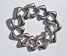 YVES SAINT LAURENT Bracelet gourmette en argent -  Circa 1990 -  Longueur : 20 cm -   Poids : 64,7g