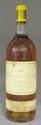 1 Magnum YQUEM 1985  Étiquette  légèrement  tachée. Label lightly stained.