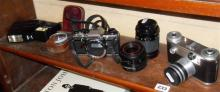 A Corfield Periflex 2 camera and an Olympus OM10 and assorted lenses and accessories