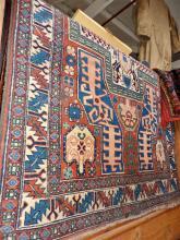 Antique Caucasian rug, a small Turkey rug and a machine-made rug