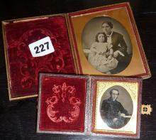 Two Victorian ambrotype photographs in cases