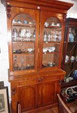 Victorian mahogany bookcase with two glazed doors above a deeper base with