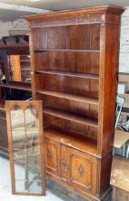 Victorian oak bookcase having astragal glazed doors above two cupboards