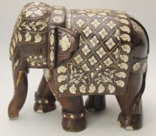 A Large Indian Elephant Standing Foursquare, the Carved Wood Inlaid with Bone,
