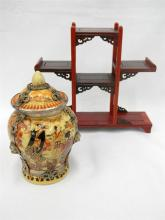 A Chinese style lidded urn plus timber [snuff bottle] stand