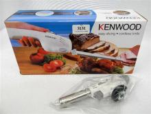 A Kenwood cordless electric knife in open box with flame gun nozzle