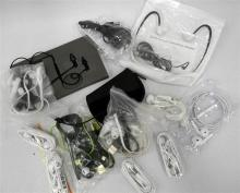 A bag of assorted ear buds & headphones