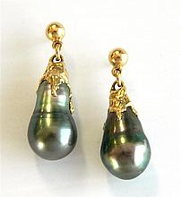 A pair of pearl earrings